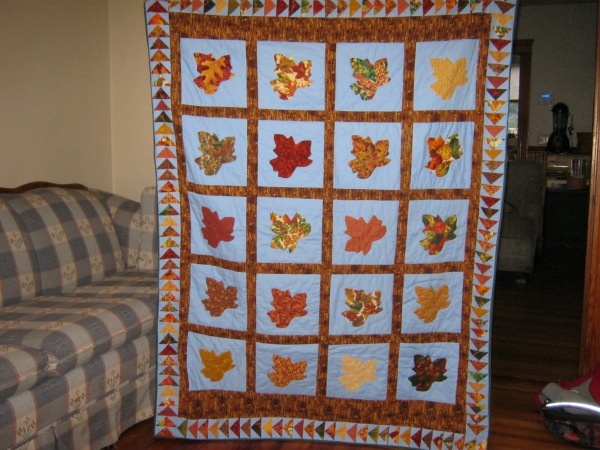 The Completed Quilt (with my daughter hidden behind)